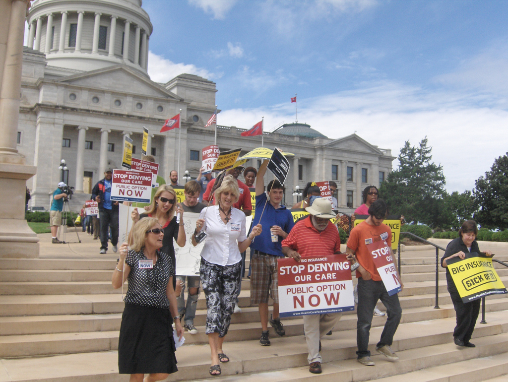 Protesters marching in favor of a public health care option
